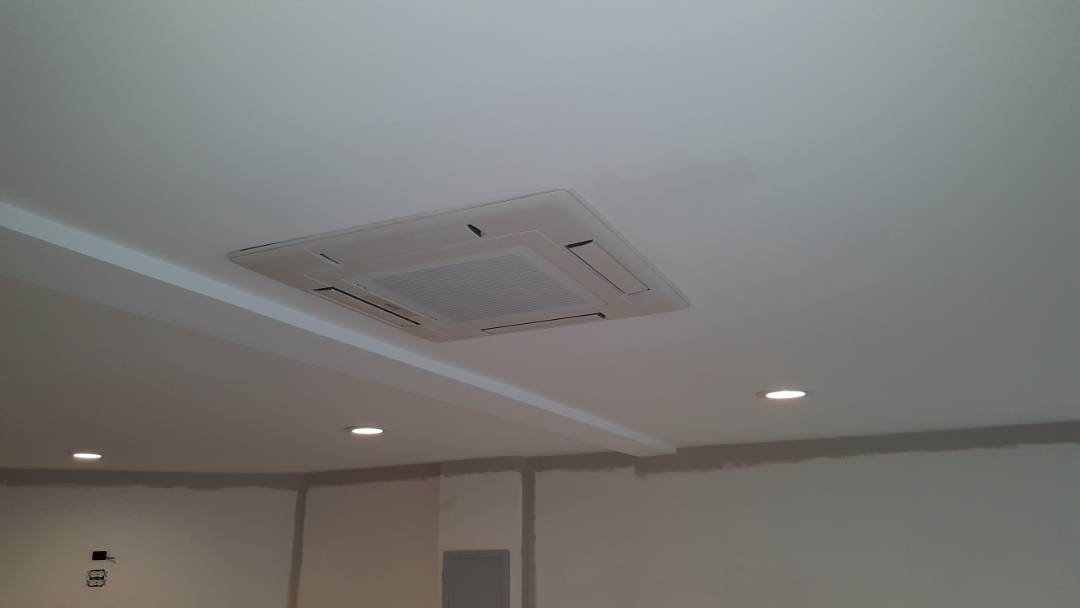 Bartlett, IL - Installing a Mitsubishi ductless heating and cooling, recessed ceiling cassette indoor unit for a garage conversion in Bartlett, IL 60103