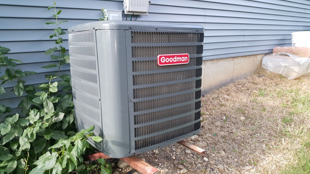 East Dundee, IL - Repairing Goodman air conditioner during emergency service call, in East Dundee, IL 60118. Customer reported water on basement floor.