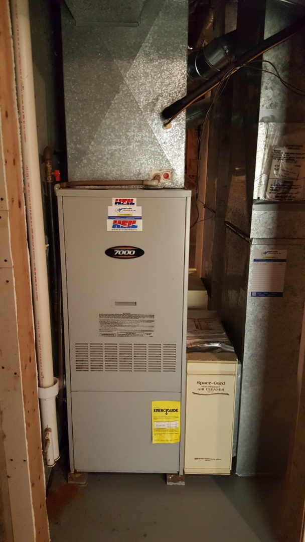 McHenry, IL - Servicing R22 refrigerant (Freon) in a Heil air conditioner in McHenry, IL 60050.