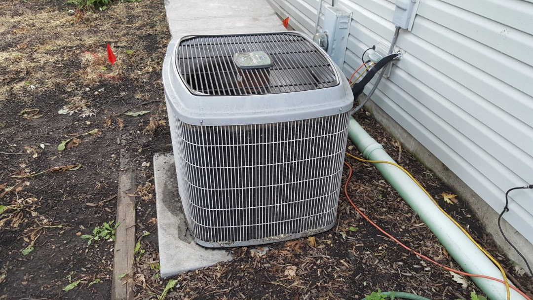 Virgil, IL - Repairing a Carrier AC system, with a bad dual capacitor, in Maple Park, IL 60151.