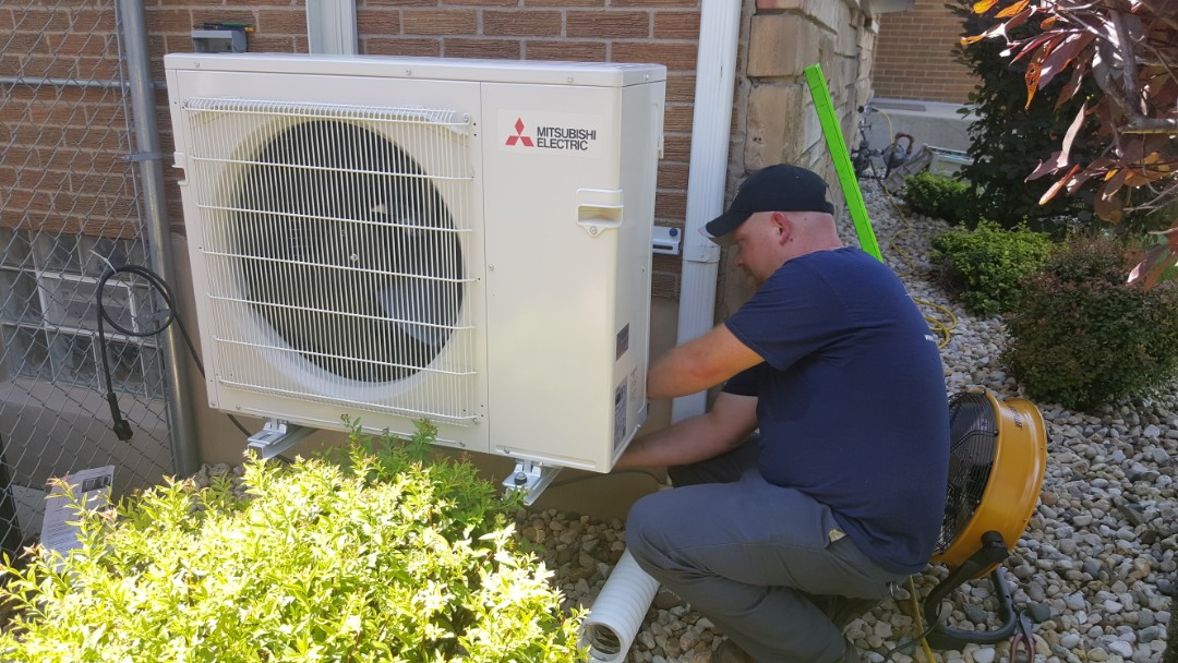 Melrose Park, IL - Installing a Mitsubishi 2- zone heat pump in a split level home which had difficulty cooling the main floor, in Melrose Park, IL 60160.