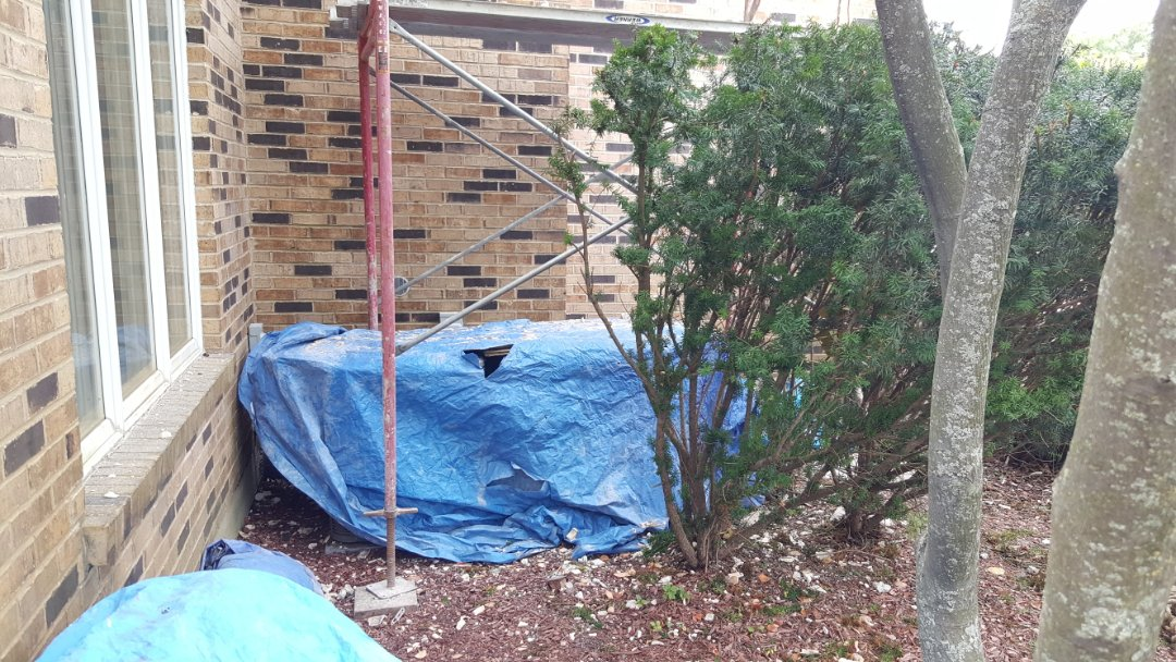 South Barrington, IL - Verifying air conditioner condenser equipment can be moved during remodeling at a home in South Barrington, IL 60010