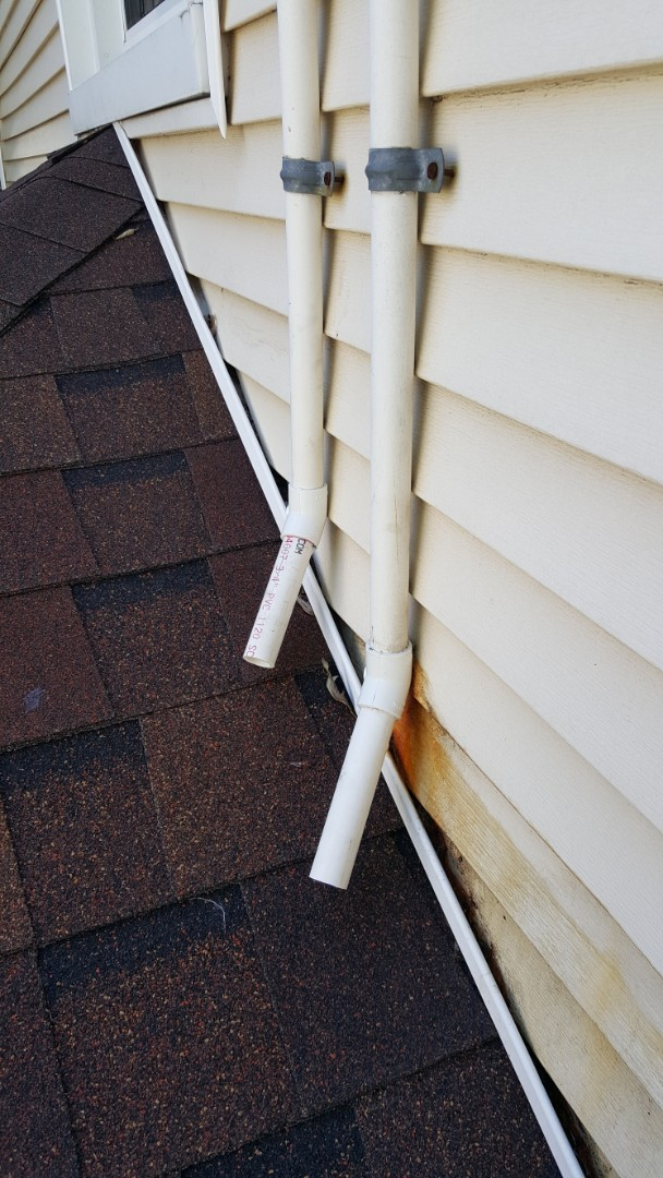 Chicago, IL - Reconfiguring air conditioner drain line PVC to prevent water, and resulting discoloration of siding, from running on siding of home.
