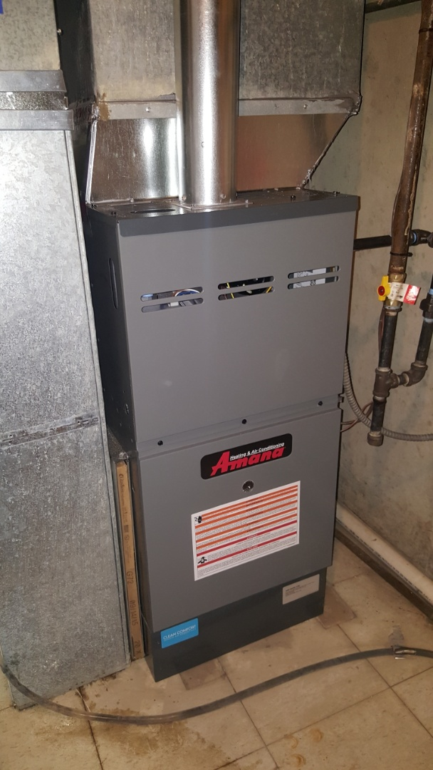 Medinah, IL - Installing an Amana 80% variable speed, 2- stage natural gas furnace; replacing a Bryant furnace with a flawed heat exchanger, in Roselle, IL.