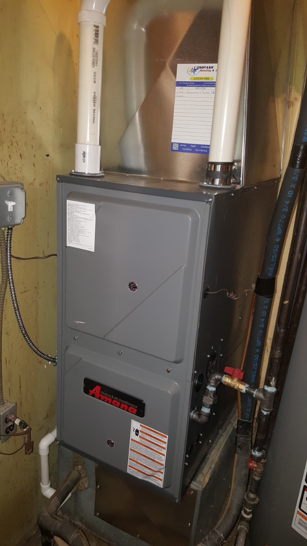 Streamwood, IL - Installing an Amana 96% 2-stage, variable speed downflow furnace and Honeywell digital programmable thermostat, in Streamwood, IL 60107.