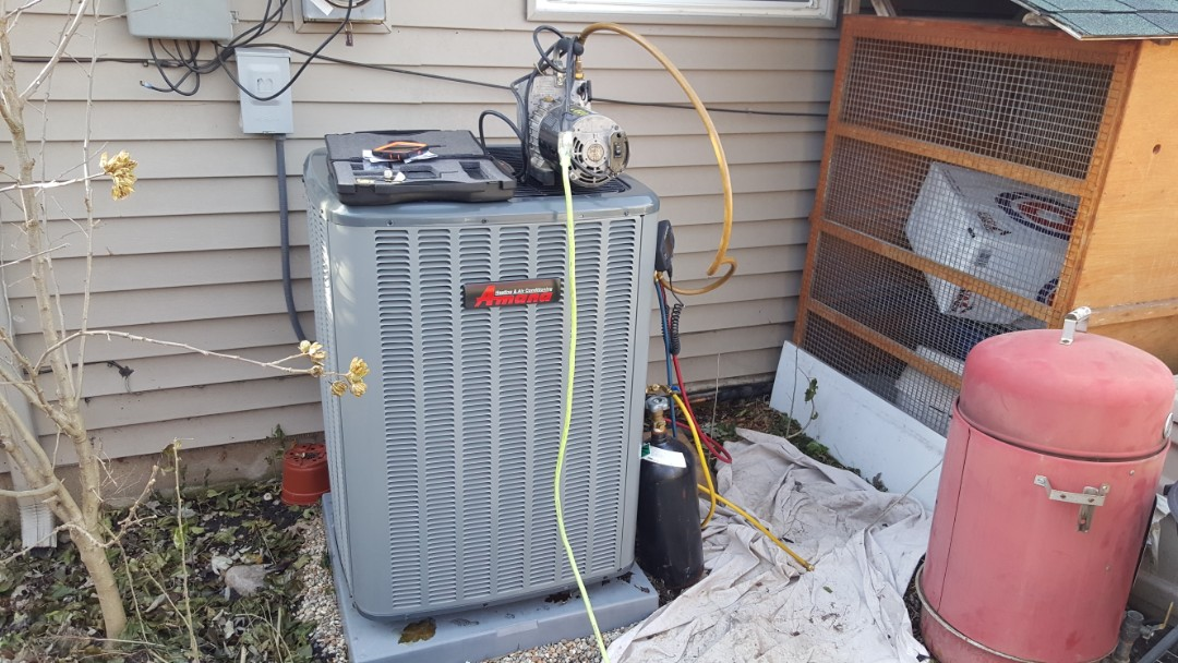 Streamwood, IL - Installing an Amana 16 SEER air conditioner and 96% 2 stage, variable speed downflow furnace, in Streamwood, IL as part of a complete system which qualifies for multiple rebates and lower utility bills substantially.