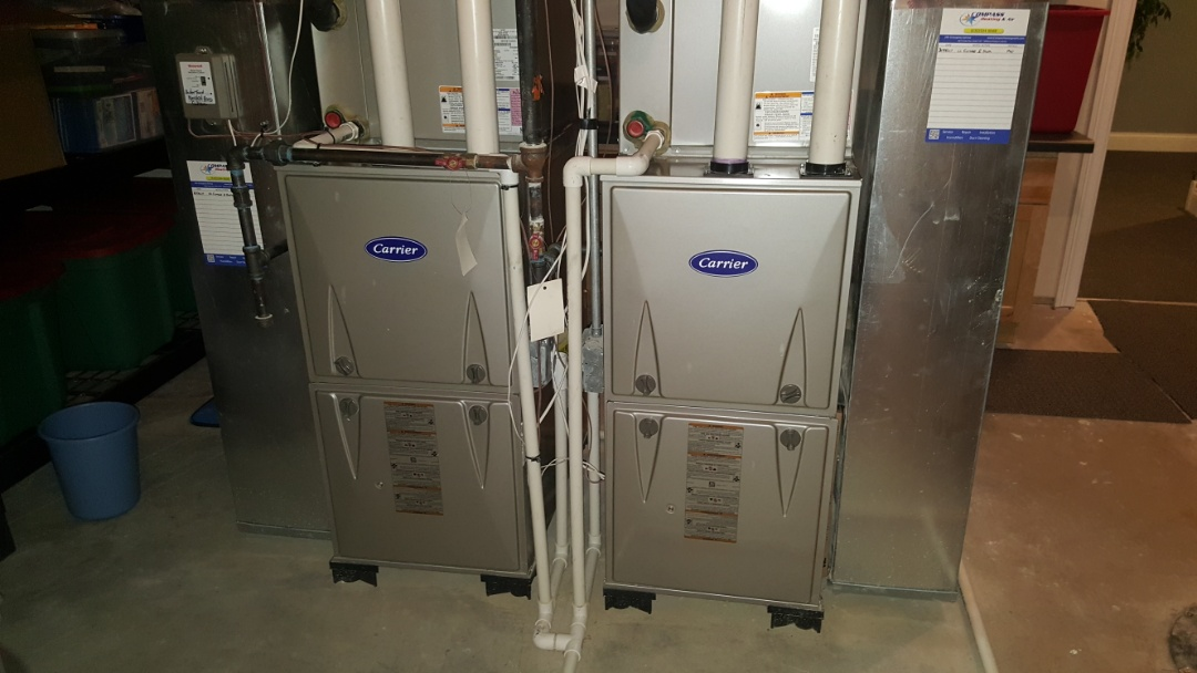 South Barrington, IL - Performing annual maintenance on 4ea Carrier high efficiency natural gas furnaces, humidifiers and cleaning construction drywall dust from blower wheels+ blower housing, in South Barrington, IL 60010.