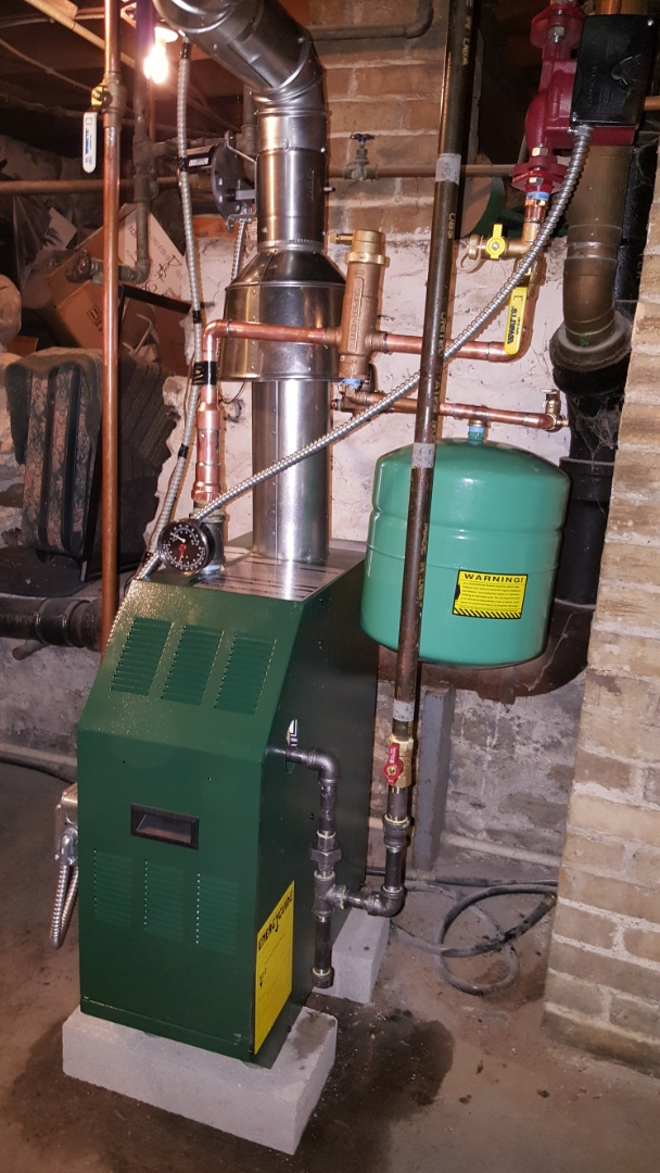 Algonquin, IL - Replacing a 40 year old Peerless boiler with a Williamson/ Weil McLain hot water boiler, bladder expansion tank, Honeywell Spirovent air eliminator and Grundfos circulating pump, in Algonquin, IL 60102.