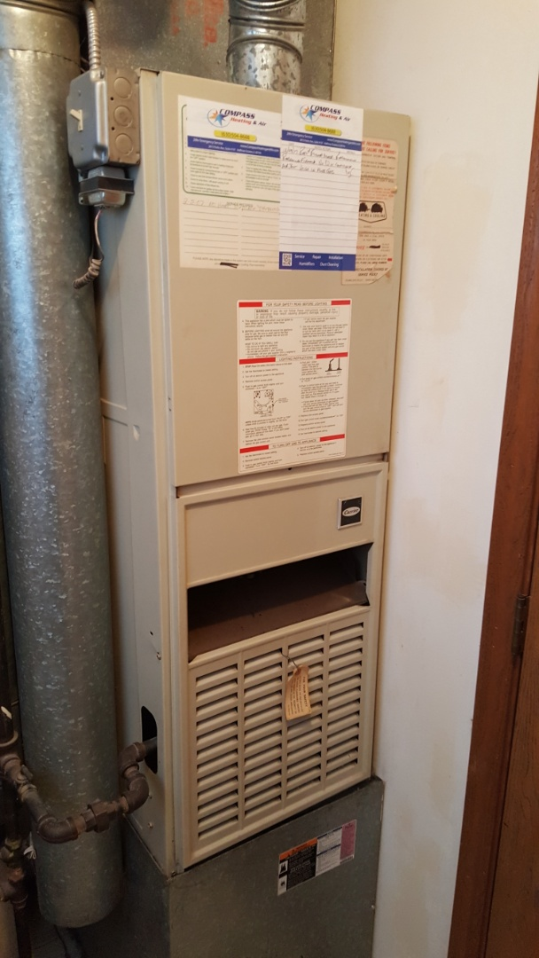 Streamwood, IL - Replacing a blower motor, during an Emergency Service/ No Heat call, on a Carrier downflow 80% standard efficiency natural gas furnace, in Streamwood, IL 60107.