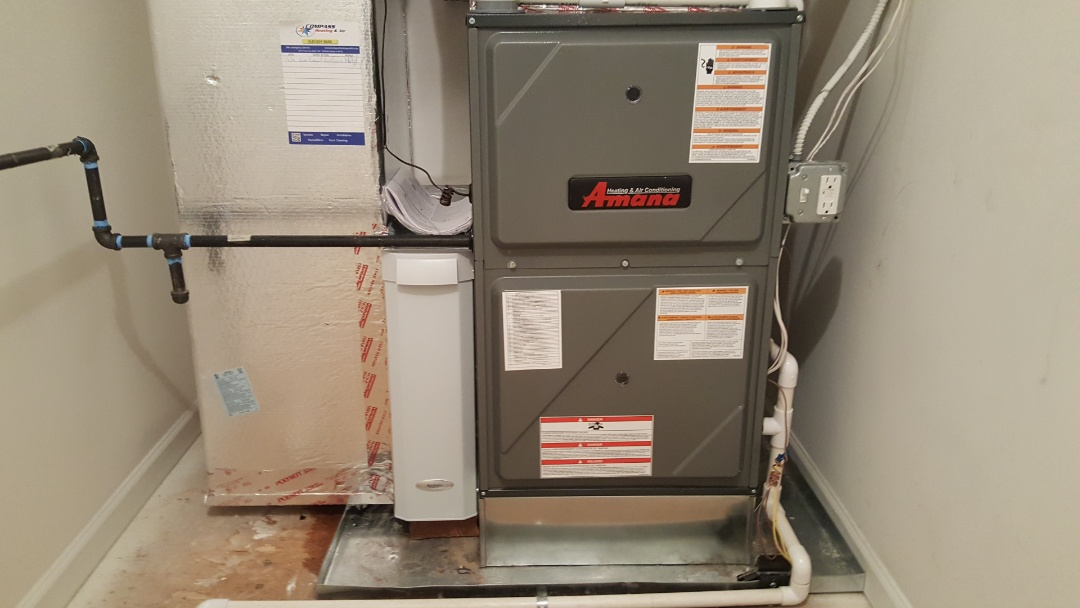 Elgin, IL - Installing an Amana 98% high efficiency modulating natural gas furnace, in Elgin, IL 60124.