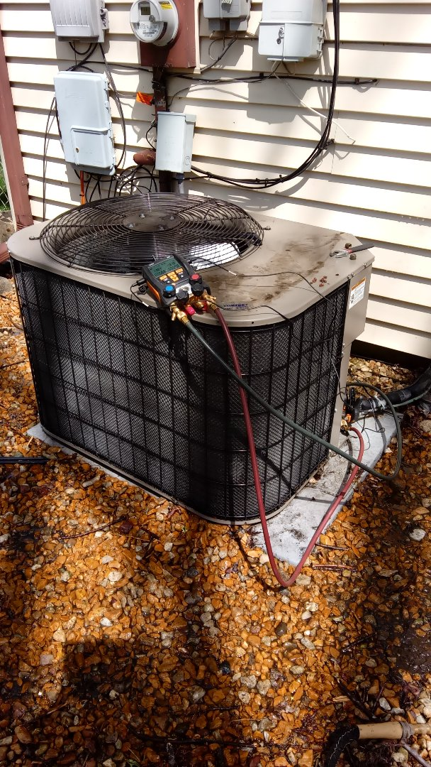 Hoffman Estates, IL - Recommended manufacturer annual maintenance on York air conditioning unit near Schaumburg
