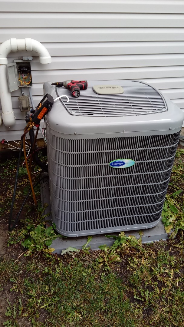 Elk Grove Village, IL - Starting manufacturer recommended annual maintenance on Carrier Infinity series Air Conditioner