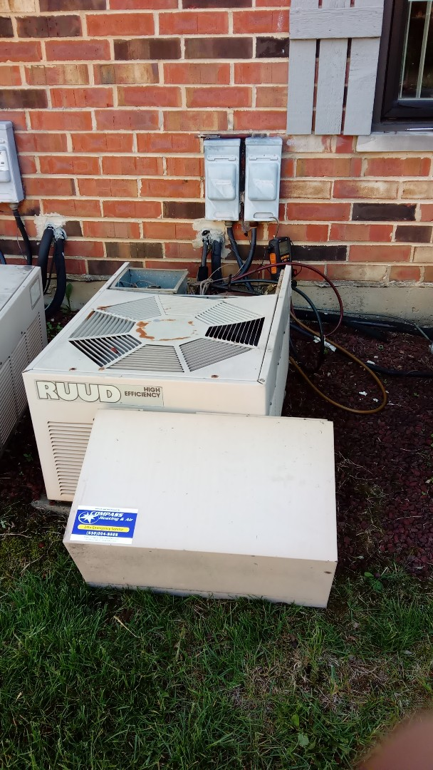 Arlington Heights, IL - Starting manufacturer recommended annual maintenance on RUDD Air Conditioner and estimate on new humidifier install