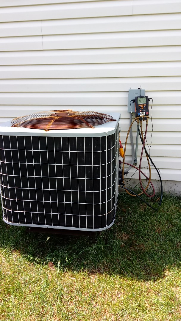 Hoffman Estates, IL - Starting manufacturer recommended annual maintenance on 18 year old Carrier air conditioner