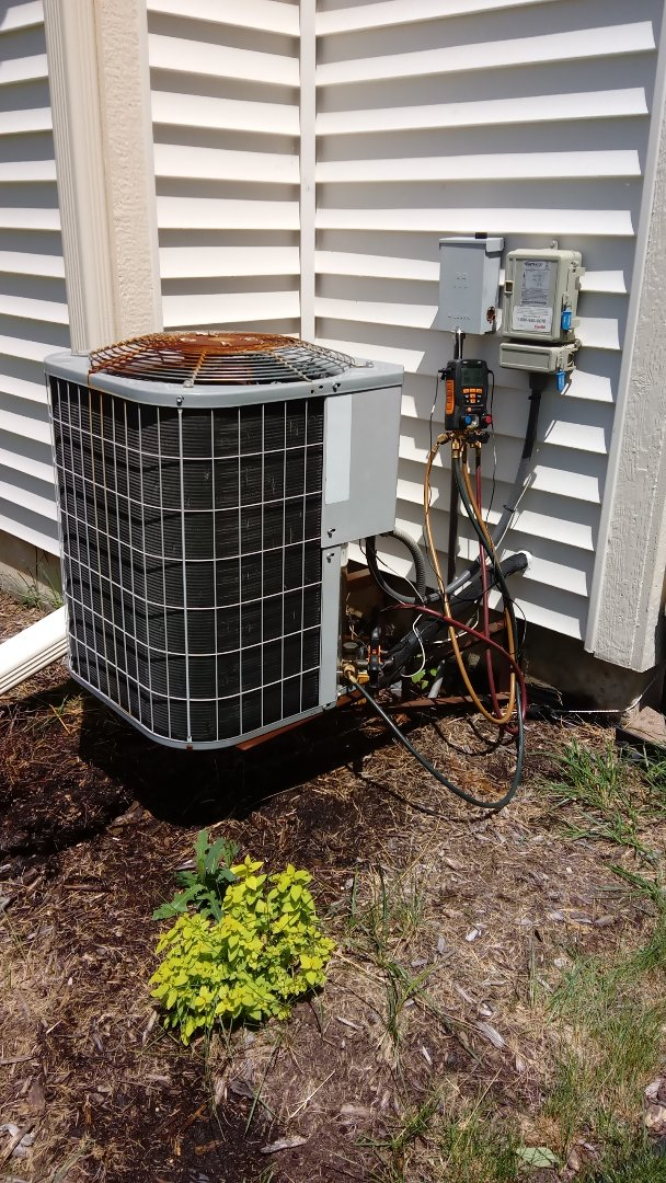 Hoffman Estates, IL - Starting manufacturer recommended annual maintenance on 15 year old Carrier air conditioner