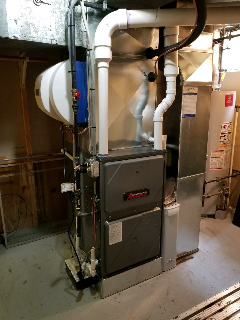 Arlington Heights, IL - Installing a new Amana modulating furnace and a high efficiency air conditioner in Arlington heights  to fix there no cooling and to save money on there electric bill