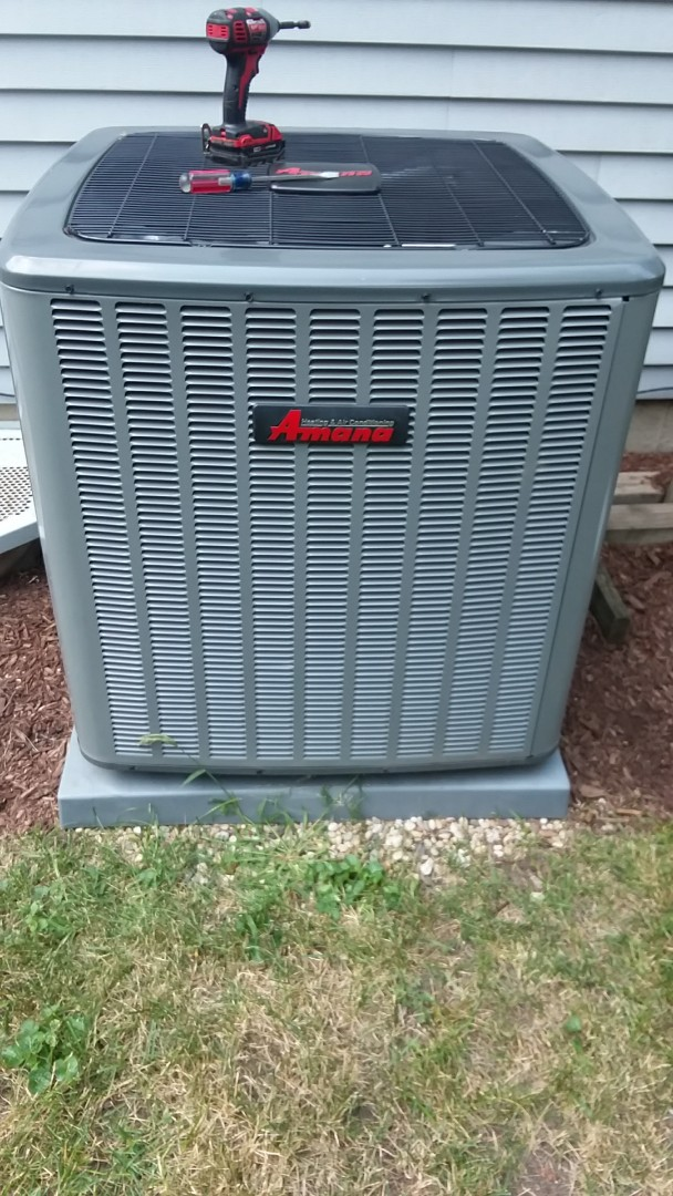 Streamwood, IL - Starting a cleaning check on an Amana air conditioner