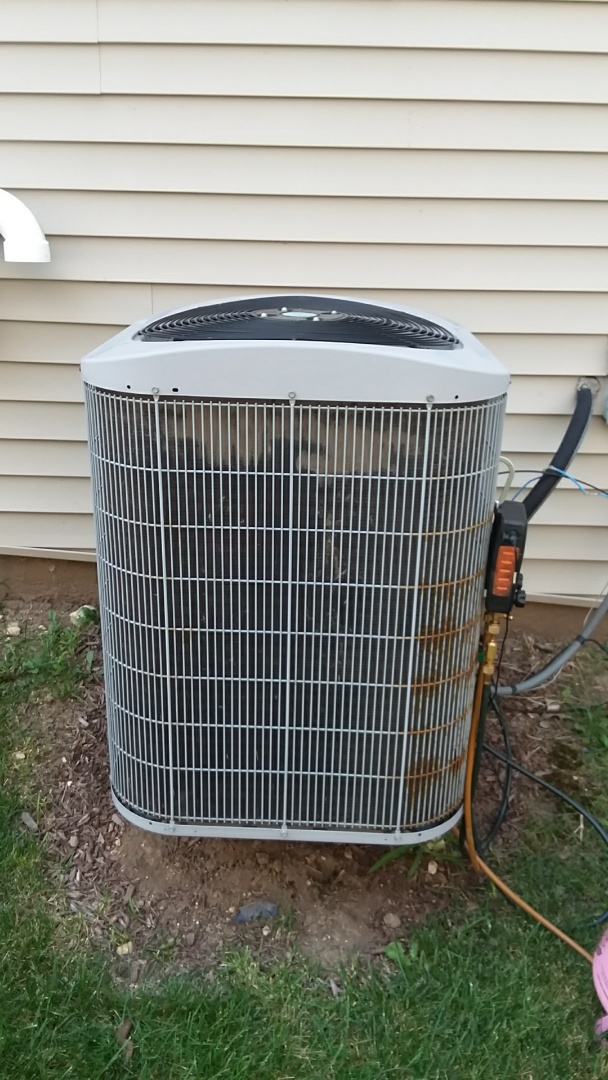 Hoffman Estates, IL - Beginning a repair on a Carrier Air Conditioner that is not cooling properly