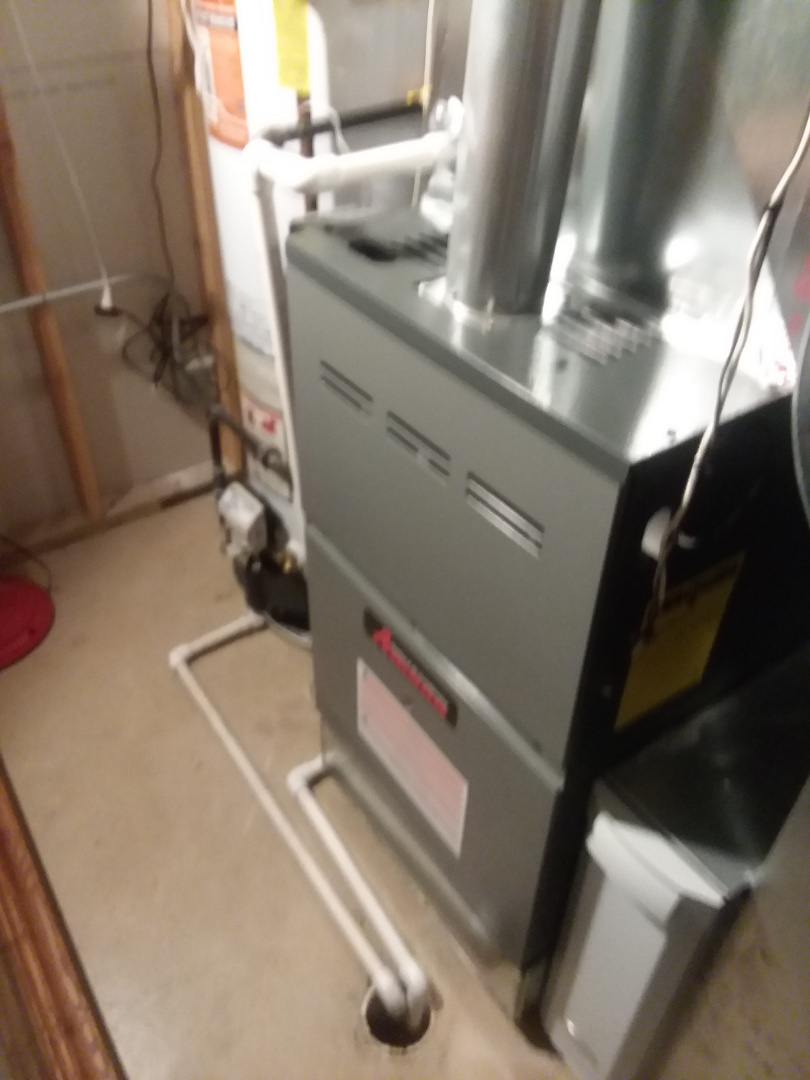 Elgin, IL - Performing annual maintenance on a Amana furnace for a Compass Heating and Air customer