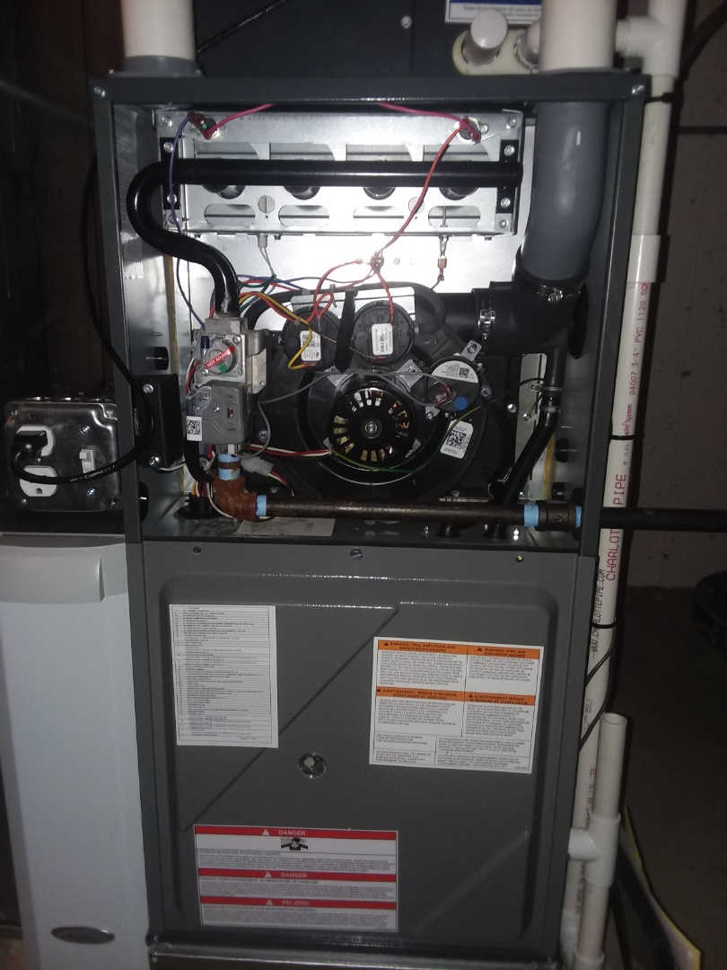 Streamwood, IL - Performing maintenance on an Amana furnace with a UV lighting system installed by Compass Heating and Air