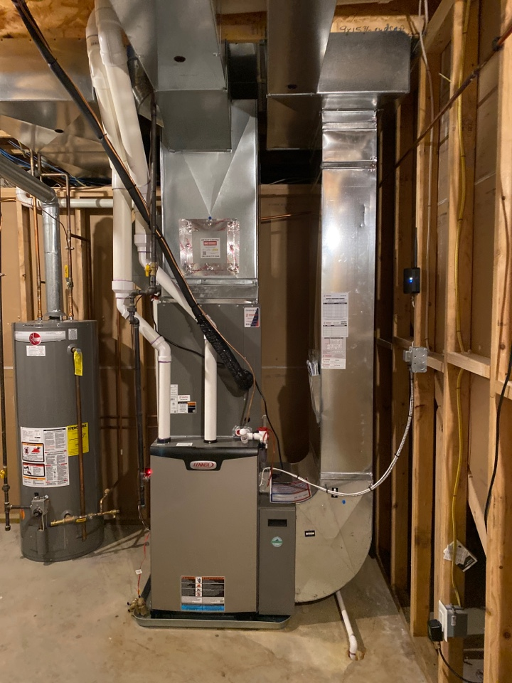 Byron Center, MI - Furnace, air conditioner, humidifier and thermostat installation call.  Performed furnace, ac, humidifier and thermostat installation on Lennox heating and cooling system