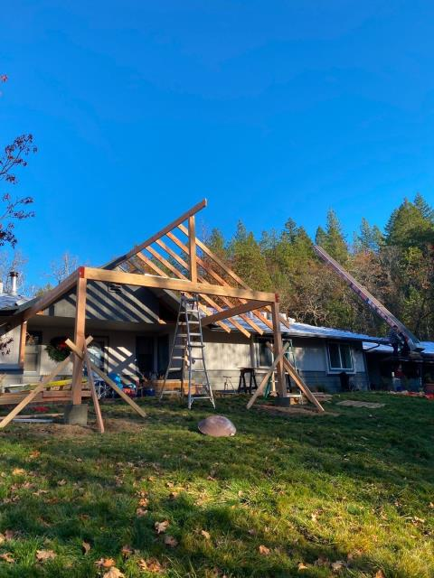 Grants Pass, OR - Out on job site building a new covered porch, in addition to this roof job.
