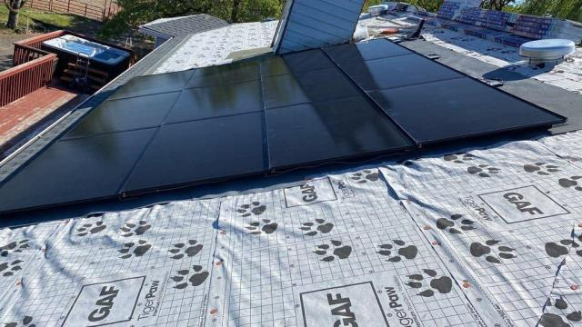 Eagle Point, OR - JAM ROOFING is out in eagle point, installing a GAF DecoTech Solar system. This specific design is integrated straight into the roof.