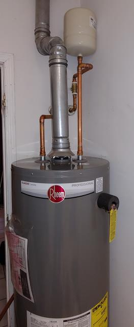 Adairsville, GA - Licensed plumber is installing a new LP (propane) Rheem water heater.