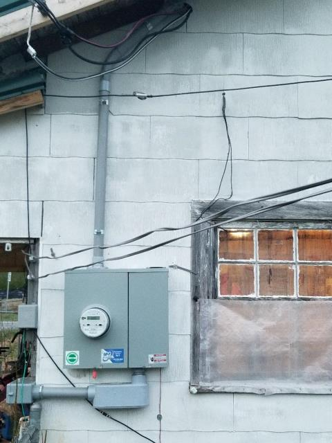 Licensed electricians are upgrading the homes electrical system to 200 amps.