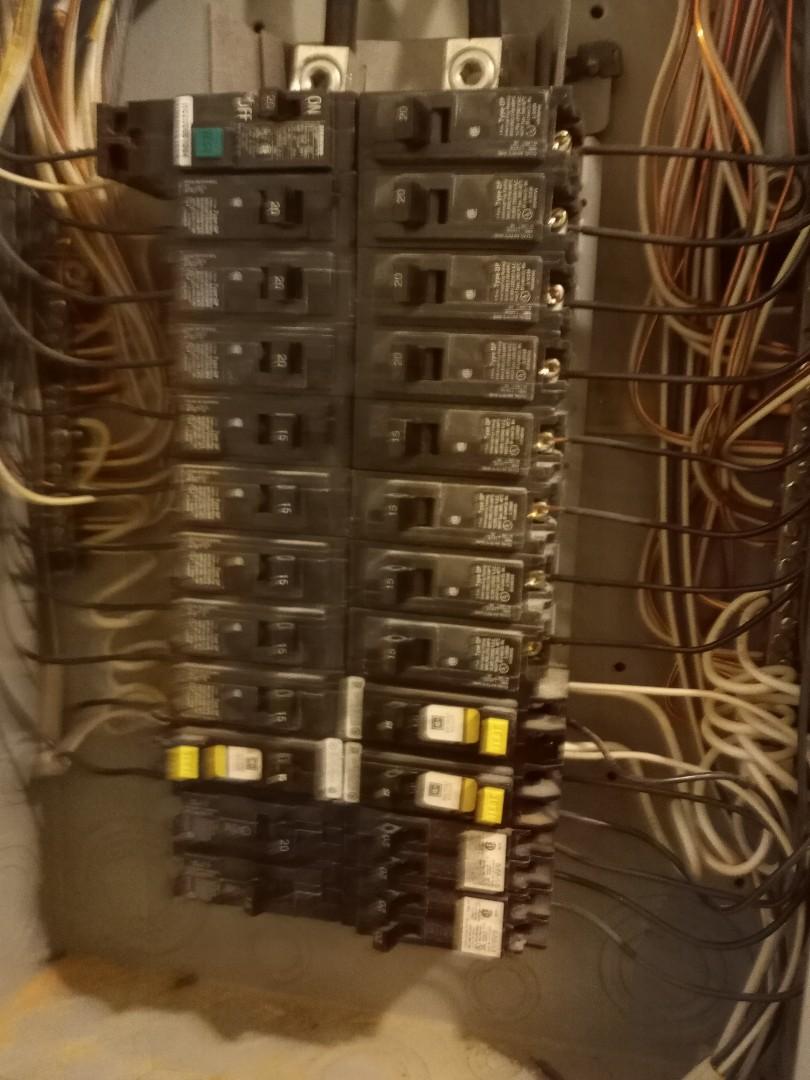 Electrician near me in Chatsworth Georgia replacing a faulty breaker