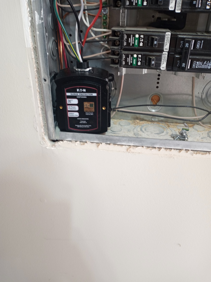 Electrician near me in Canton Georgia installing our fault breaker and surge protection in panel