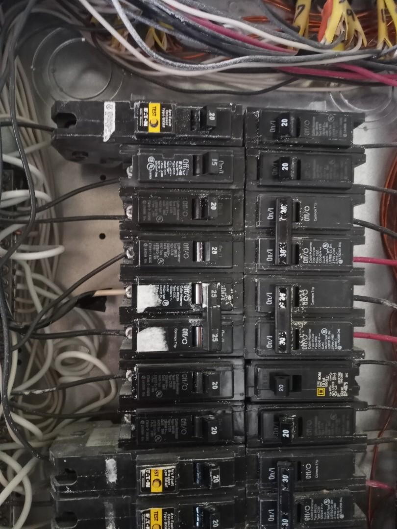 Electrician near me in Rockmart Georgia replacing faulty breaker