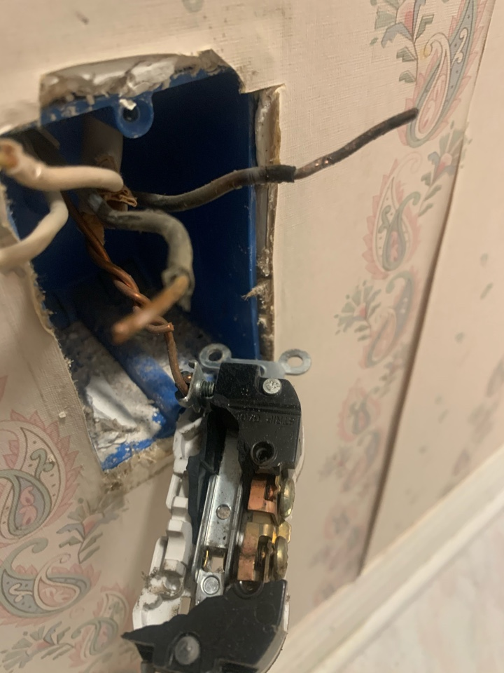 Electrician near me in chatsworth ga repaired burnt outlet.