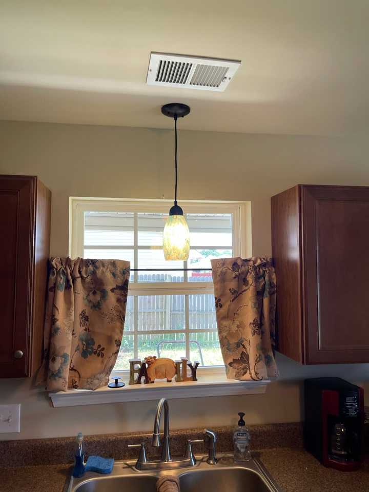 Electrician near me in ringgold ga added a new light fixture over a kitchen sink.