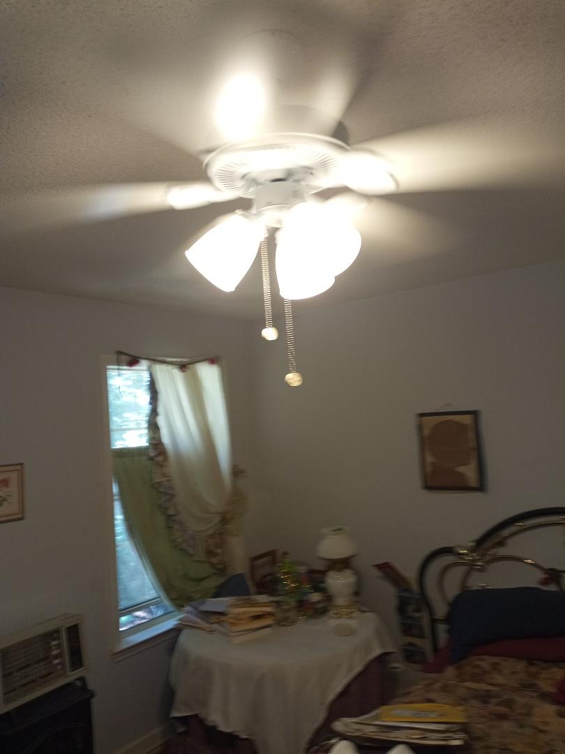 Electrician near me in Dalton Georgia installing ceiling fan
