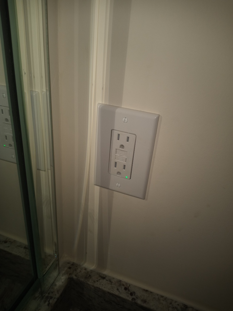 Electrician near me in Acworth Georgia is installing GFCI receptacles