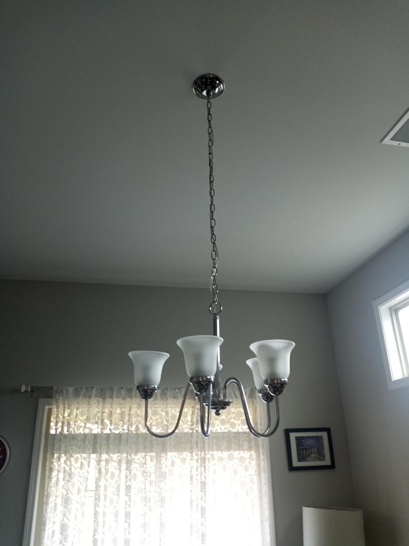 Electrician near me in Canton Georgia installing light fixtures