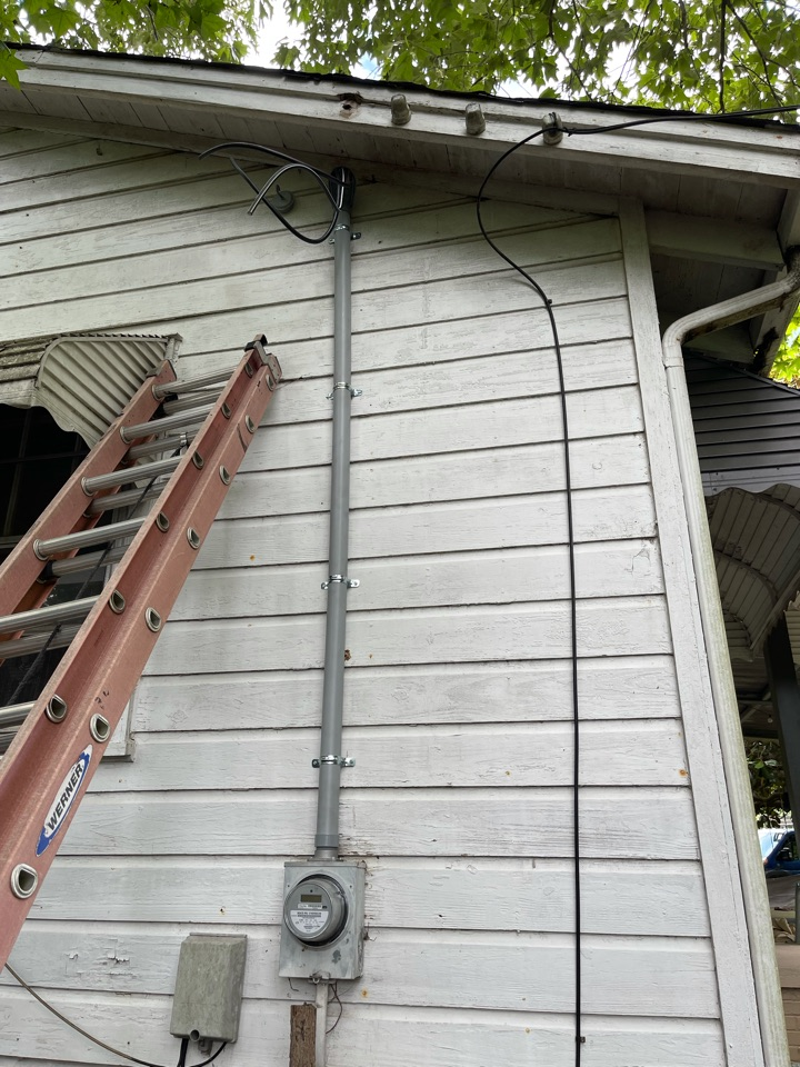Electrician near me in Smyrna ga replaced old mast due to store damage.