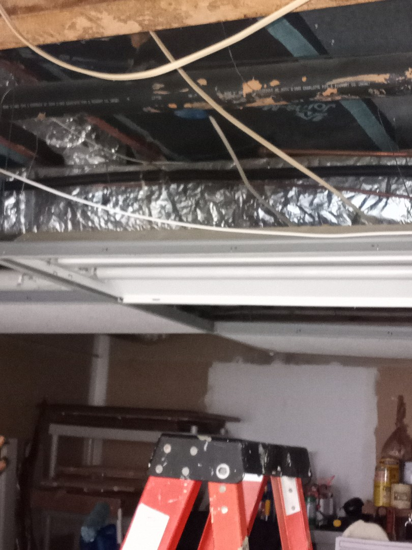 Electrician near me in Marietta is giving a free electrical estimate for lighting project in garage