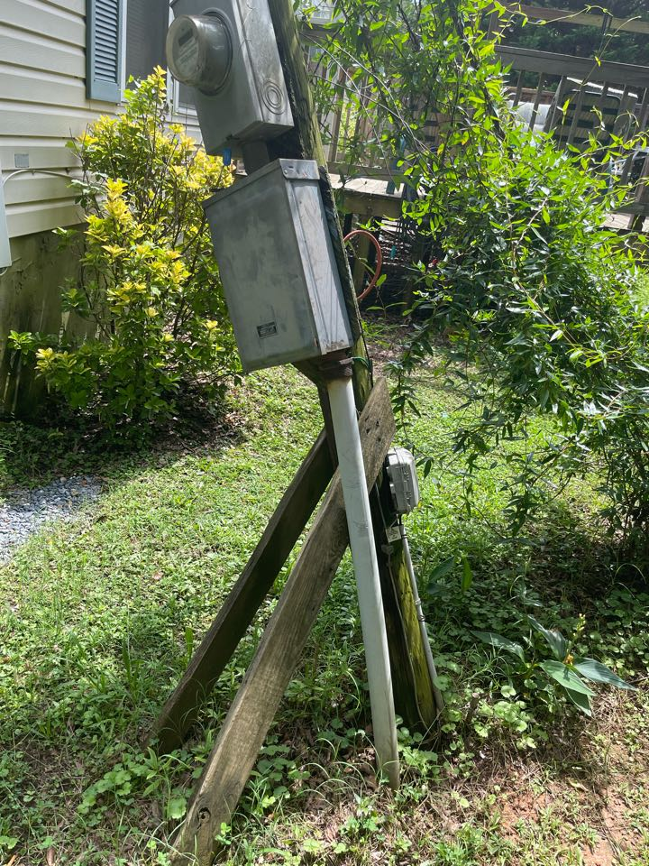 Electrician near me in Kingston ga replaced old service pole with new