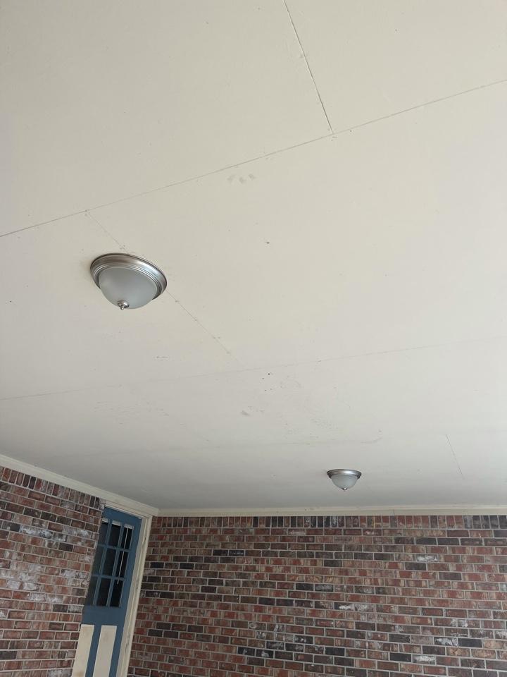 Electrician near me in Calhoun ga installed 2 new light fixtures in carport.