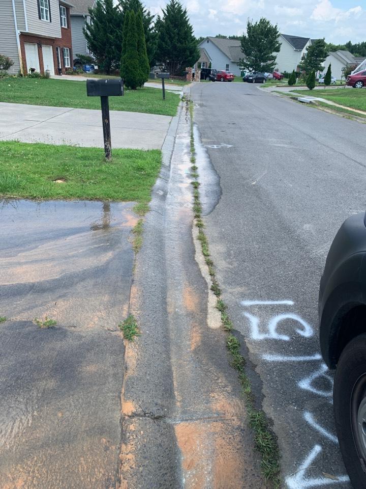 Plumber near me Calhoun Georgia. Busted water service under driveway