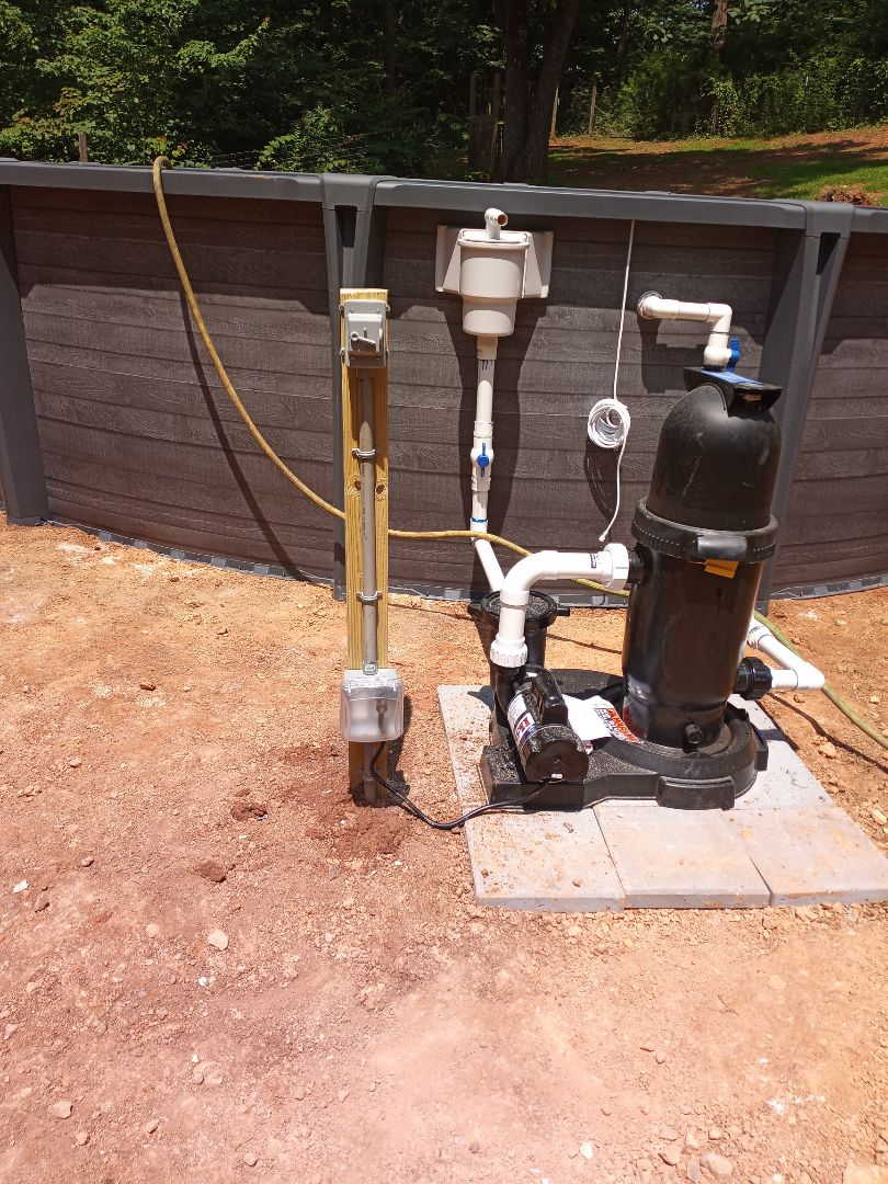 Electrician near me in Adairsville Georgia installing exterior circuit for pool pump
