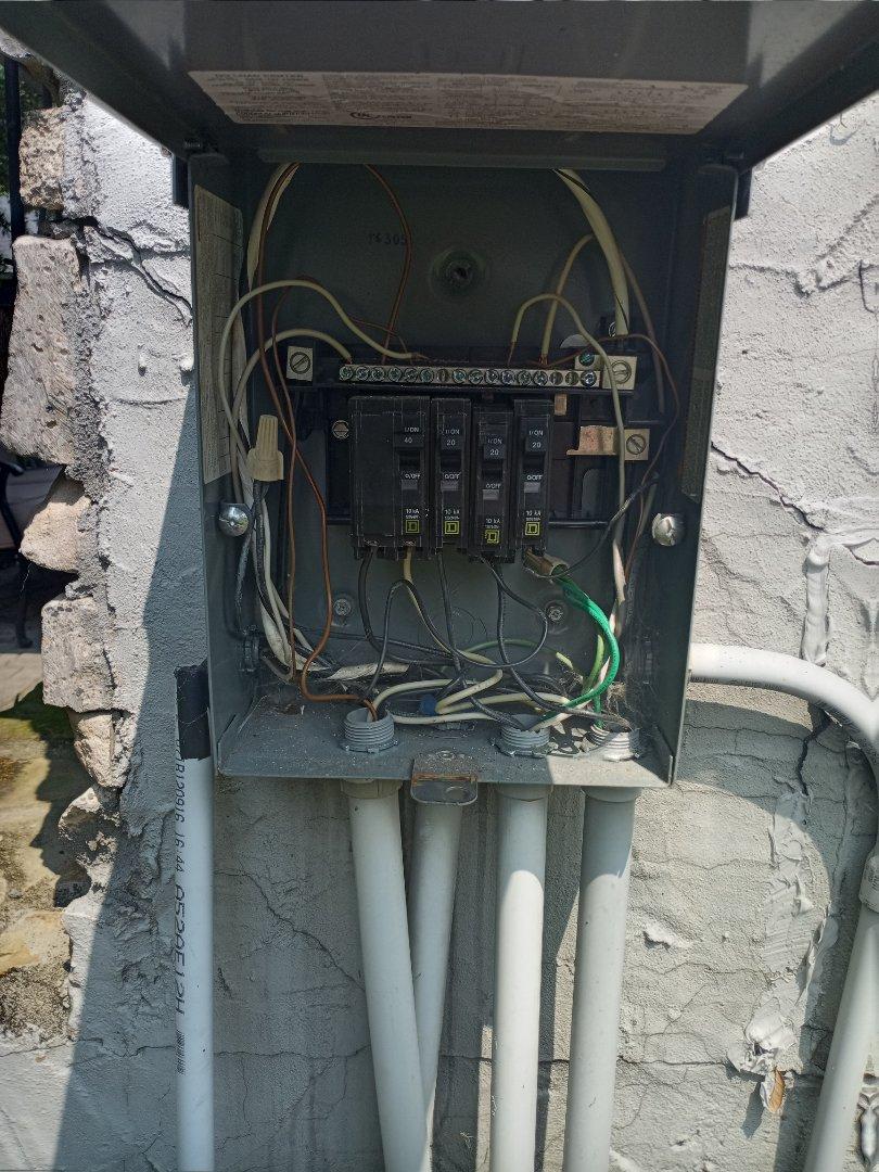 Electrician near me in Chatsworth Georgia repairing exterior panel