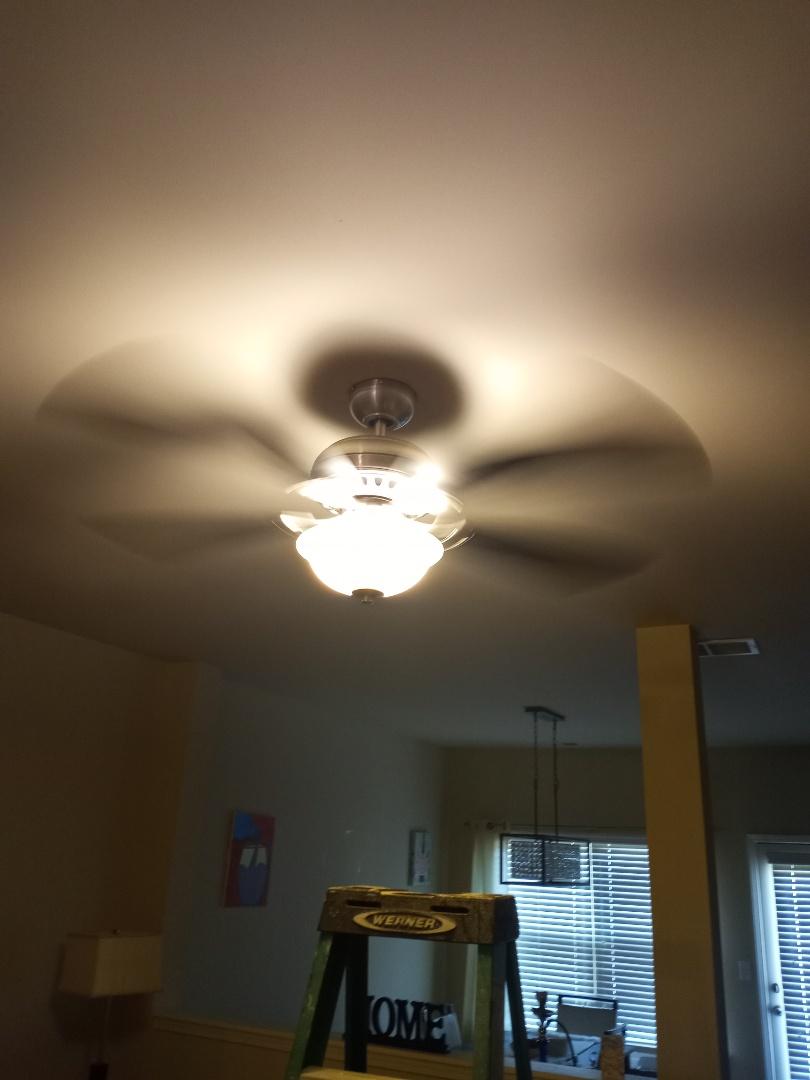 Electrician near me in Kennesaw Georgia installing a ceiling fan