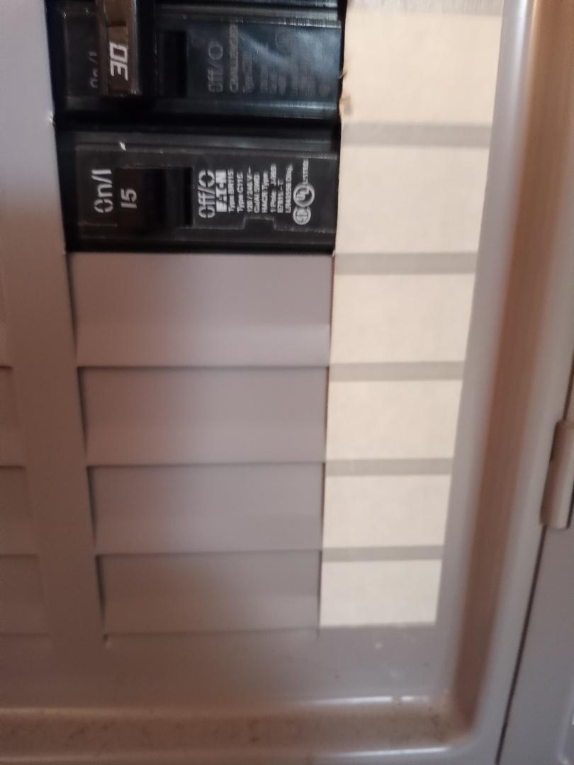 Electrician near me in Cartersville Georgia is replacing  bad breaker