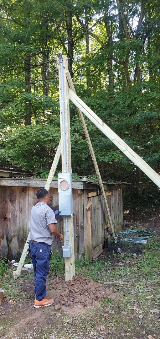Electrician near me is installing a temporary power pole,  we are the best local Electricians and are experts in power outage repair!