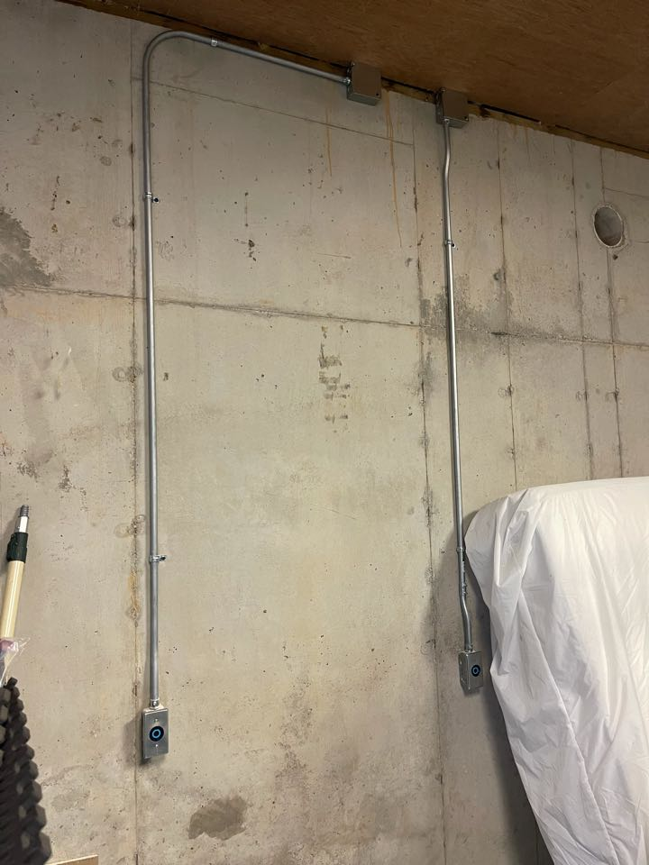 Electrician near me in chickamauga ga installed multiple 240v plugs on a concrete basement wall.