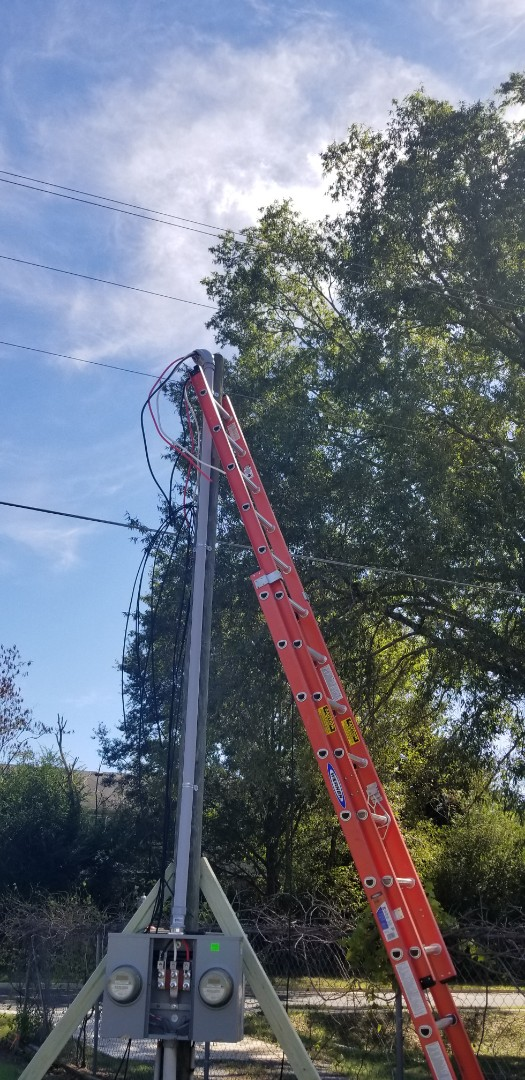 Adairsville, GA - Certified electricians are repairing an electrical service mast that was damaged. EaZy Electrical Services offers great options on electrical service mast repair.