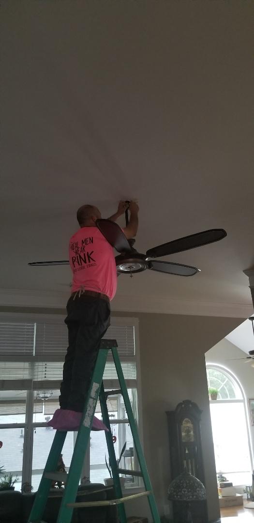 Woodstock, GA - Electricians are installing a new ceiling fan.